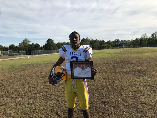 BTW-Tuskegee's Joseph Graham Jr. poses with his player of the week award.