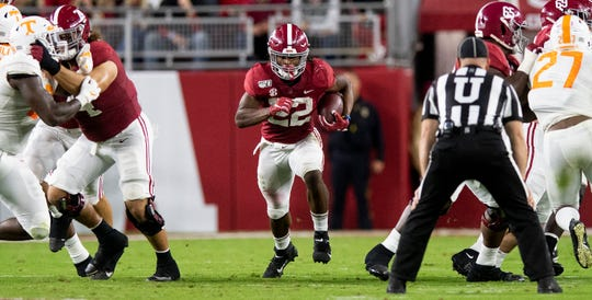 Alabama running back Najee Harris (22) runs through a big hole in the line against Tennessee at Bryant-Denny Stadium in Tuscaloosa, Ala., on Saturday October 19, 2019.