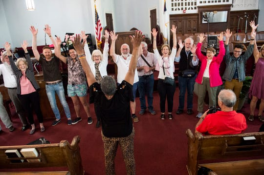 Tour Director Wanda Battle sings with tourist at Dexter Avenue King Memorial Baptist Church in Montgomery, Ala., on Tuesday, Oct. 22, 2019.