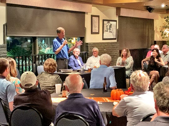 Rich Lamb, the director of golf for the City of Fort Myers for over 40 years, speaks at a ceremony honoring him on Wednesday at The Edison restaurant at Fort Myers Country Club. Lamb also was given a key to the city by Mayor Randy Henderson.