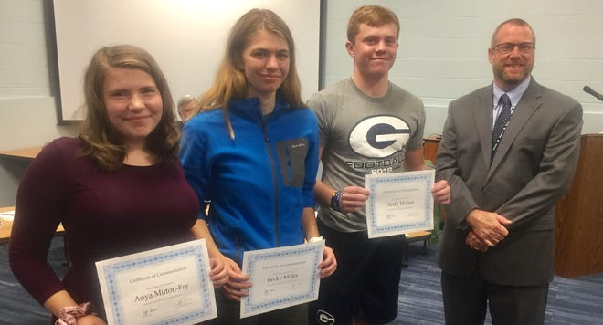 """""""National Merit Semifinalists"""" Anya Mitton-Fry, Becky Miller and Andy Hoben with Granville Schools Superintendent Jeff Brown."""