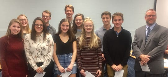"""""""Commended Scholars"""" include Rudy Bradley, Cade Brautigan, Riley Chodak, Naudia Ferbrache, McKenna Fuhrman, Annika Green, MaryKate Hill, Nathaniel Homan, Alexandra Mazik, Allison Moore, Abigail Parsons and Tate Smith. Those present Oct. 21 are seen with Superintendent Jeff Brown."""