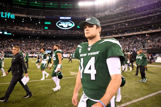 New York Jets quarterback Sam Darnold (14) walks onto the field after losing to the New England Patriots, 33-0, at MetLife Stadium on Monday, Oct. 21, 2019, in East Rutherford.