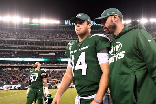 New York Jets quarterback Sam Darnold (14) and head coach Adam Gase walk off the field together after a disappointing shut-out loss against the New England Patriots at MetLife Stadium on Monday, Oct. 21, 2019, in East Rutherford.