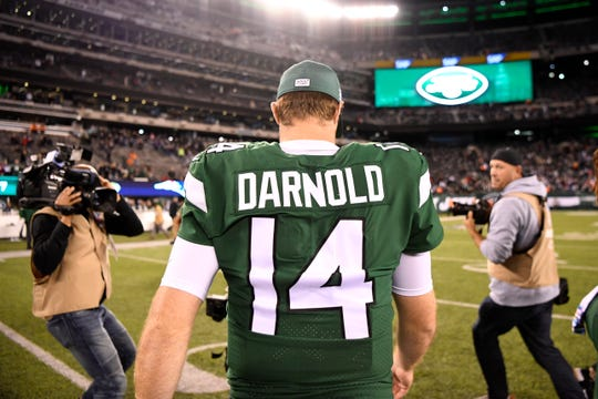 New York Jets quarterback Sam Darnold (14) walks off the field after a shut-out loss to the New England Patriots at MetLife Stadium on Monday, Oct. 21, 2019, in East Rutherford.