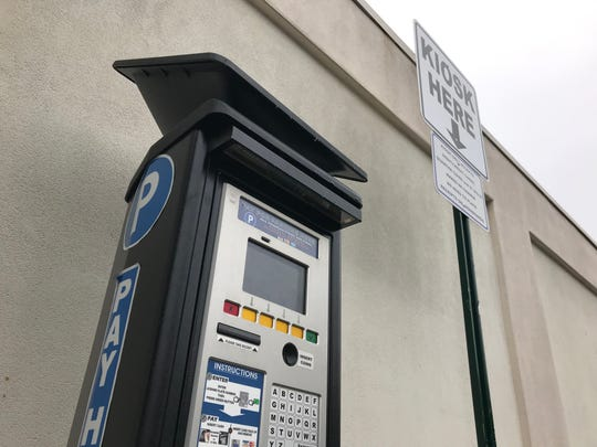 A pay-by-plate smart parking kiosk in a parking lot off Ridgewood Avenue.