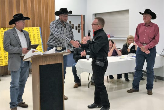 Otero County Sheriff's Deputy Preston Eldridge, center, received the 2019 Crime Stopper of the Year award at the 24th Crime Stoppers Banquet Oct. 19. Also pictured: Otero County Sheriff David Black, left, Otero County Law Enforcement Director to Crime Stoppers Theo Livingston shaking Eldridge's hand and Eldridge's father Teddy Eldridge, right.