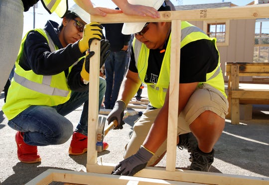 Bond Wilson Technical Center student Julius Smith uses a hammer to secure part of a dog house during the construction technology competition at Skills Fest on Oct. 22 at Navajo Technical University in Crownpoint.