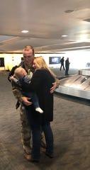 Alexis Halteman introduces Easton to his dad, Kaleb Halteman at Detroit Metro Airport