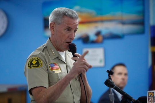 San Bernardino County Sheriff John McMahon speaks to community members at the Sportman's Club in Joshua Tree who gathered to reject the possibility of placing convicted sex offender Ross Leo Wollschlager in their community.
