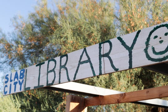 A sign for Slab City Lizard Tree Library sits outside on Friday, October 18, 2019.