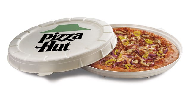 Pizza Hut's new Garden Specialty Pizza is served in a new, compostable round box.