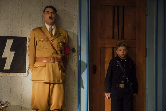 "In ""JoJo Rabbit, young JoJo (Roman Griffin Davis) has a friend no one else can see: Adolf Hitler (Taika Waititi)."
