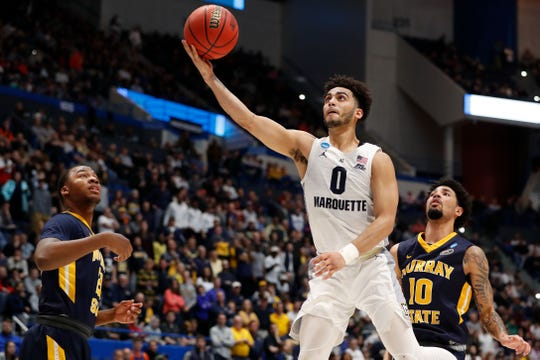 Mar 21, 2019; Hartford, CT, USA; Marquette Golden Eagles guard Markus Howard (0) attempts a layup against the Murray State Racers during the second half off a game in the first round of the 2019 NCAA Tournament at XL Center. Mandatory Credit: David Butler II-USA TODAY Sports