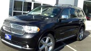 Investigators identified the vehicle involved in a hit-and-run as a dark-colored 2012-2016 Dodge Durango similar to the vehicle in this photo.