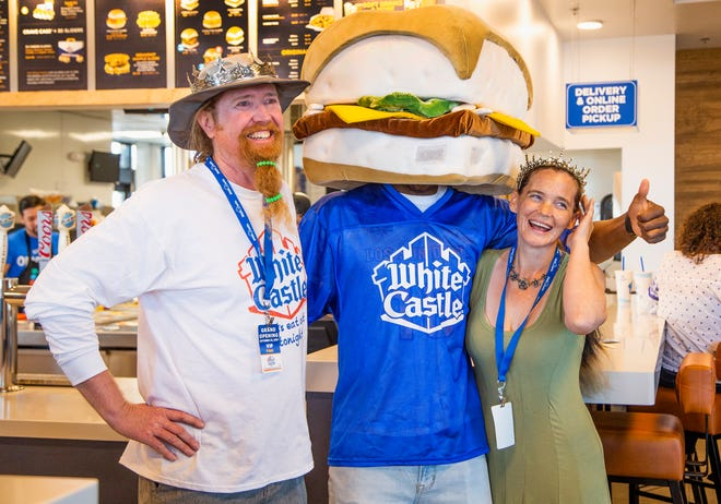 Drew Schmitt (left) and Jamie West, of Fountain Hills, were the first two people in line for the opening of the new White Castle restaurant in Scottsdale. The couple, pictured on Oct. 22, 2019, have been camped out in a travel trailer in front of the restaurant since Saturday, Oct. 19, 2019. Final preparations were underway at 9310 E. Via de Ventura near Scottsdale.