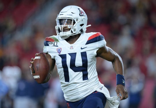 October 19, 2019: Arizona Wildcats quarterback Khalil Tate (14) runs the ball against the Southern California Trojans during the second half at the Los Angeles Memorial Coliseum.