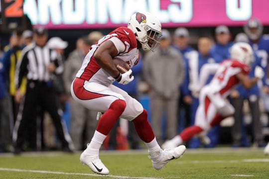 Arizona Cardinals' David Johnson runs the ball during the first half of an NFL football game against the New York Giants, Sunday, Oct. 20, 2019, in East Rutherford, N.J.