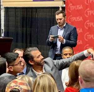 Donald Trump Jr. takes a selfie as he mingles with the crowd after an appearance at Grand Canyon University in Phoenix on Oct. 21, 2019.