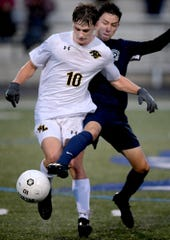 Red Lion's Zach Stambaugh is defended by Dallastown's Nicholas Nilphai during District 3 Class 4-A soccer action at Dallastown High School Tuesday, October 22, 2019. Bill Kalina photo
