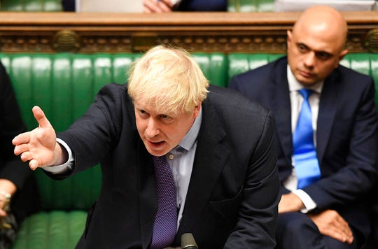 Britain's Prime Minister Boris Johnson gestures as he speaks in the House of Commons in London during the debate for the EU Withdrawal Agreement Bill, Tuesday Oct. 22, 2019. (Jessica Taylor, UK Parliament via AP)