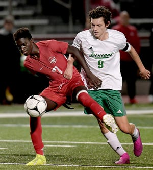 Susquehannock's Fallou Cisse, left, is pressured by Donegal's Philip Herzog in District 3 Class 3-A soccer action at Susquehannock High School Monday, October 21, 2019. Bill Kalina photo