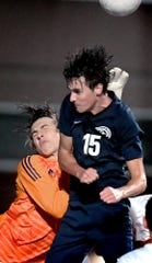 Red Lion goalkeeper Levi McKeever, left, collides with  Dallastown's Michael Shirey after making a save during District 3 Class 4-A soccer action at Dallastown High School Tuesday, October 22, 2019. Bill Kalina photo