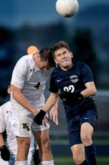 Dallastown's Zander Leik and Red Lion's Sean Barley vie for a header during District 3 Class 4-A soccer action at Dallastown High School Tuesday, October 22, 2019. Bill Kalina photo