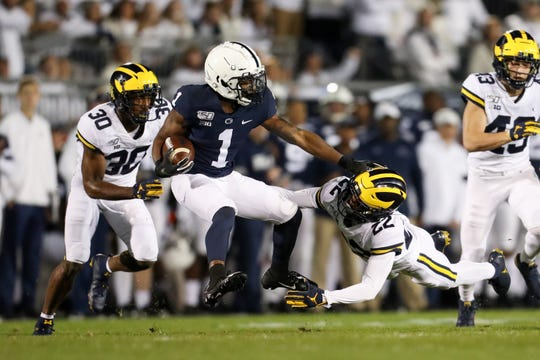 Oct 19, 2019; University Park, PA, USA; Penn State Nittany Lions wide receiver KJ Hamler (1) runs with the ball while trying to avoid a tackle from Michigan Wolverines defensive back Gemon Green (22) during the first quarter at Beaver Stadium. Penn State defeated Michigan 28-21. Mandatory Credit: Matthew O'Haren-USA TODAY Sports