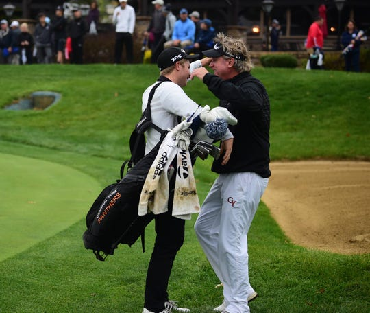 Central York's Carson Bacha hugs head coach Sean Guerin after clinching the PIAA Class 3A title at Heritage Hills Tuesday.
