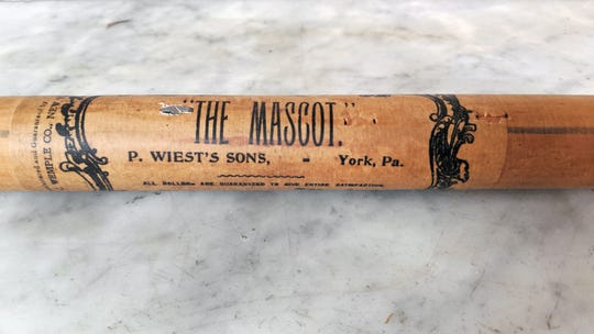An old shade roller found in the home hints at the Weist family retail business in the early 20th century.