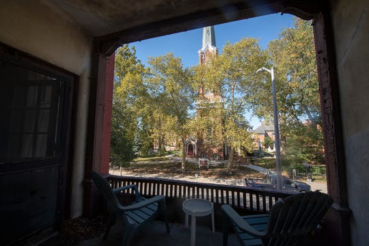 This is looking out the second-floor, enclosed porch at the First Presbyterian Church across East Market Street. The iconic porch belongs to a Dempwolf-design home in York recently purchased with plans for its preservation.