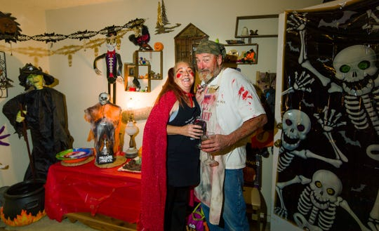 Michael and Tracie Willard pose for a photo during a costume party at their home.
