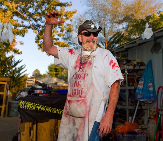 Fake blood covers Michael Willard during a costume party Oct. 12 at his home, which he transforms into a haunted Halloween scene.