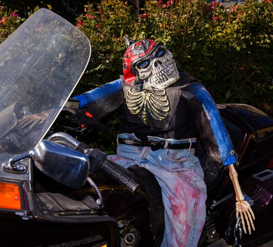 A bloody skeleton sits atop a motorcycle in Michael and Tracie's front yard.