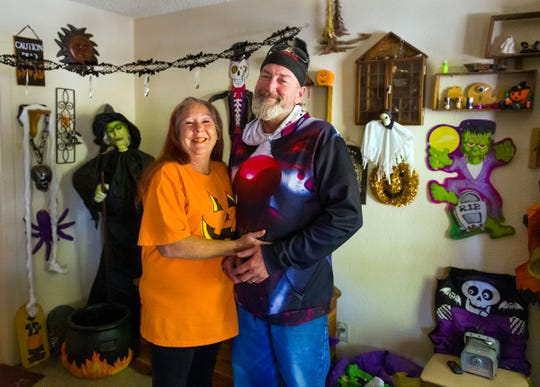 Michael Willard and his wife, Tracie, decorate the inside and outside of their home for Halloween.
