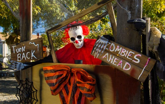 """A life-sized clown warns visitors to turn back at the """"Willard Dead and Breakfast"""" spooky yard display at 122 N. West St., Yerington."""