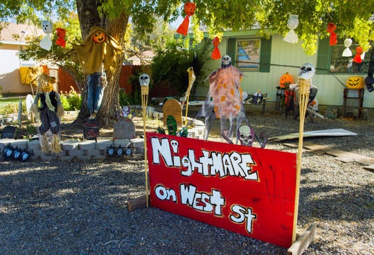 """Michael and Tracie Willard go all-out decorating for Halloween. This year's theme is """"Nightmare on West Street."""""""