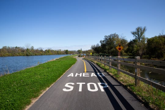 A section of freshly-paved trail in German Flatts, New York, runs alongside the Erie Canal. This section is part of New York State's 750-mile Empire State Trail that, when completed, will pass through 26 counties and many key attractions. Friday, October 11, 2019.