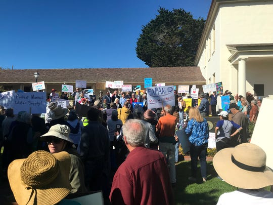 Protesters and local government leaders gather on the lawn of Colton Hall in Monterey to rally against California American Water's proposed desal plant. Oct. 21, 2019.