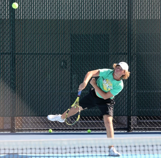 San Angelo Central High School's Cameron Coker hits a shot during practice at the Tut Bartzen Tennis Complex on Monday, Oct. 21, 2019.