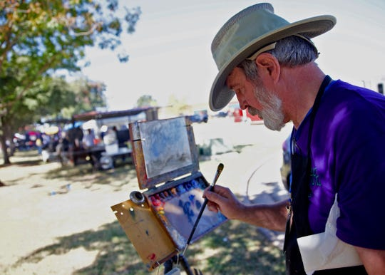 Bill Suys paints a picture outside during the Brews, Ewes and BBQ festival in San Angelo on Saturday, Oct. 19, 2019.