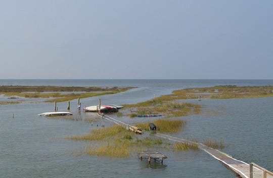 An unusually high tide swamps part of Fox Island in 2004.
