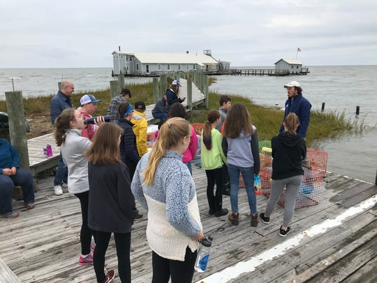 Jeff Varnon, Fox Island's education program manager for the Chesapeake Bay Foundation, works with one of the last groups of students to visit the island.