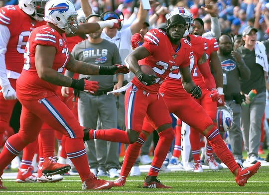Buffalo Bills cornerback Tre'Davious White, right, celebrates his interception at the goal line in the second half against Miami on Sunday in Orchard Park, N.Y.