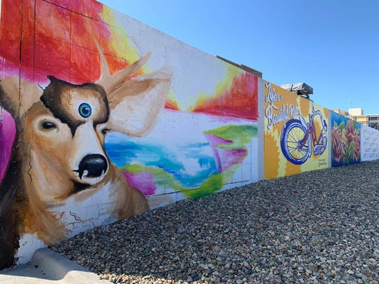 Work is nearing completion on a series of five art murals on an exterior wall of a parking ramp at 101 E. Sixth St. in downtown Sioux Falls.