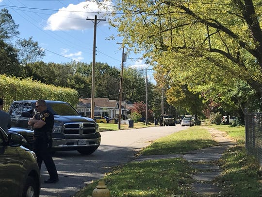 Springfield Police block off a section of East Cairo Street. Officials say a wanted subject is in a house on that street.