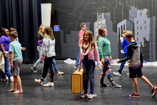 Kate Collins Middle School students rehearse on Oct. 15 for their production of Thoroughly Modern Millie, the school's first musical with Choral Music Director Flint Dollar.