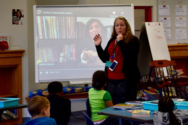 William Perry Elementary Librarian Megan Carroll asks a class a question on Oct. 17, 2019.