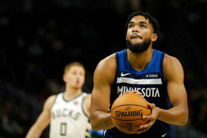 Minnesota Timberwolves' Karl-Anthony Towns shoots a free throw during the second half of a preseason NBA basketball game against the Milwaukee Bucks Thursday, Oct. 17, 2019, in Milwaukee.